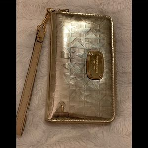 Micheal kors golden color wristlet/ wallet
